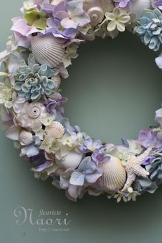 gorgeous wreath with seashells and silk flowers