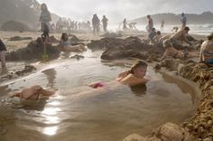 New Zealand (Hot Water Beach) dig a hole and make your own personal spa!! Geothermal mineral waters and holes everywhere, then high tide comes and washes them away to be dug again the next day!