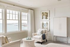 Perched on a cliff and overlooking the ocean, the home has a boat-like feel, especially in the master bedroom with its large windows. To maximize the idyllic setting, Palumbo layered the room in neutrals so nothing distracted from the view.