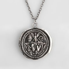 Nurturing Talisman Necklace: This handcrafted talisman necklace features keys, which represent guardianship and the eagle and the owl both signify protection. The heart is a symbol of love. $202