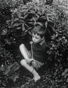 Crippled Boy Holding Dandelion by Foot