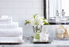 Guest bath white and marble accents // white towels // glass jar with soaps // silver tray with flowers and accessories // The Complete Bath Bathroom Staging, Bathroom Tray, White Bathroom, Home Staging, Relaxation Room, White Towels, Inspired Homes, Beautiful Bathrooms, Luxury Furniture