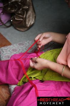 Rescued girls are paid Fair Trade wages for making Red Thread Movement bracelets. Many use this money to open their own businesses when they leave the safe house.