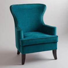 Featuring a broad back, deep seat, and rolled arms, our handsome Pacific Blue Elliott Wingback Chair offers a modern update to this classic silhouette. Finished with tapered, solid wood legs and nail head detail, it makes a stunning yet comfortable seating choice that is exclusive to World Market.