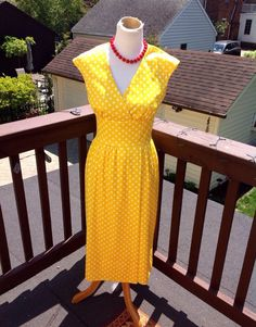 A personal favorite from my Etsy shop https://www.etsy.com/listing/294933983/cheery-yellow-polka-dot-dress-excellent