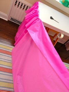 Here's a great idea for creating a gathered skirt with a plastic party tablecloth.