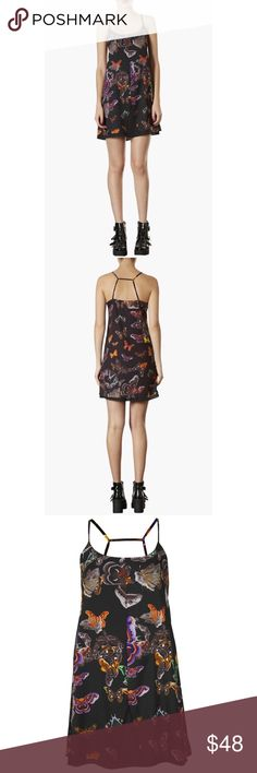 """NWT Topshop Butterfly Moth Printed Slip Dress S A solid underlayer peeks out from beneath a featherweight moth-print dress finished with a wispy cage-strap back. * 35"""" length (size 8). * 100% polyester. * Machine wash cold. * By Topshop; imported. * Savvy. Comes from a smoke and pet free home. Item is new with tags and has never been worn.  My prices are firm. No trades or holds. No transactions off of poshmark. Topshop Dresses Midi"""