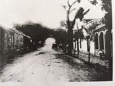 Moritz Loewenstein seated (at right) before his house on Alameda Street in Ysleta, just west of intersection with Zaragosa Road.  1914.