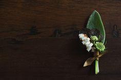 nice boutonniere: pieris japonica, anemone, lamb's ear, scabiosa and wild grass