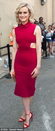 Red hot! Taylor, 30, highlighted her slender figure in a tight sleeveless number featuring...