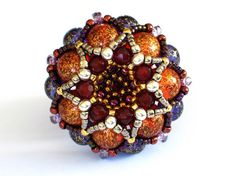 Beaded beads by Gwen Fisher. Seven Sisters Cluster Pendant