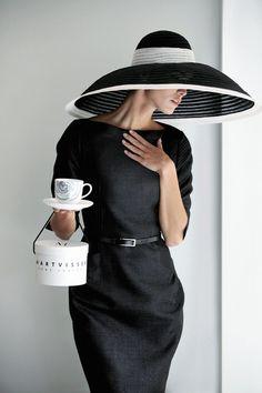 Black dress; black and white accessories