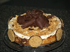 This is a richly, smooth peanut butter cheesecake recipe with a delicious sour cream, peanut butter topping.It is baked in a 10 inch spring form pan.