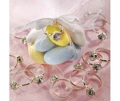 Engagement Ring Favor Charms - Party City - resource for buying rings for game, where guests hunt for rings hidden throughout party and put them on. Guest with the most found rings wins a prize. Elegant Wedding Favors, Wedding Favor Bags, Wedding Boxes, Wedding Rings, Wedding Ideas, Fake Engagement Rings, Bridal Lingerie Shower, Bridal Showers, Engagement Party Favors