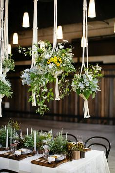 Macrame Wedding: 10 Knotty Wedding Decor Ideas Borrowed from the - Macramé hanging plant centerpieces. Credit: McKenzie Powell Floral & Event DesignBorrowed from the - Macramé hanging plant centerpieces. Plant Centerpieces, Wedding Centerpieces, Wedding Table, Wedding Decorations, Table Decorations, Wedding Ideas, Wedding Reception, Centerpiece Ideas, Wedding Aisles