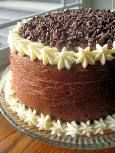 Chocolate Layer Cake with Cream Cheese Filling and Chocolate Buttercream | FoodGaZm.. I'm gonna make this for Christmas! ;)