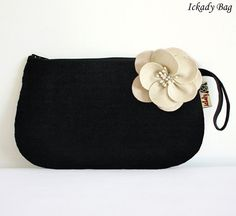 black with white flower clutch