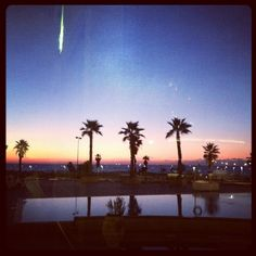 sunset overlooking the pool + beach in Tel Aviv