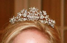 The diamond and pearl Antique Corsage Tiara has a history that passes it through the hands of Queens from three different countries. Queen Victoria of Sweden owned a stomacher that could be used as a set of brooches. This piece was inherited by Queen Ingrid of Denmark (who was Victoria's granddaughter). Ingrid set the brooches up as a tiara and gave it to her daughter, Princess Anne-Marie, as an 18th birthday present.