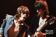 Mick and Keith on stage at the Empire Pool, Wembley (now known as Wembley Arena) in 1973. Photo by Michael Putland