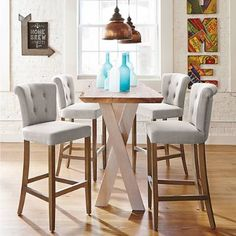 Gather a gorgeous group of sculpted, fabric-upholstered Tristan stools around the kitchen counter or at the wine cellar bar. Each is dressed in natural-hued, linen-like performance fabric. The sculpted seat features a button-tufted back and a rolled crest rail that altogether balance beautifully atop warm-toned, natural-finished solid hardwood legs finished with a brushed, nickel-finished kick plate. With details like this, these versatile stools will have everyone sitting up ...
