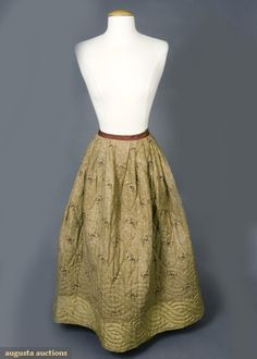REVERSIBLE QUILTED PETTICOAT, FRANCE, 1800-1850 November, 2007 -Tasha Tudor Historic Costume Collection New Hope, PA Tan silk damask, hem hand quilted in undulating wave design, reverses to cocoa brown ground printed with vertical cream dashes and widely spaced red flower sprays with 5 silk hem border, knife pleated to brown linen waist band