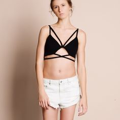 Caged Bralette / Crop Top Caged Bralette or crop top. Available in black and ivory. This listing is for the BLACK. Unpadded but thick material. This is an ACTUAL PIC of the item - all photography done personally by me. Please do not use photos without permission. Brand new. Junior sizing. NO TRADES. Bare Anthology Tops Crop Tops