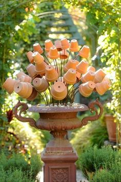 A sculpture of terracotta pots decorates Freeland Tanner's Napa, Calif., garden on Saturday, Oct. 27, 2012. Photo: Noah Berger, Special To The Chronicle / SF