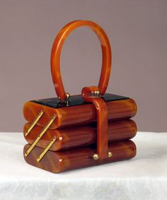 Caramel Bakelite Purse, Augusta Auctions -- Small box shape opens to 3 tiered sections, mirror under top, brass findings, x x (View 1 of Vintage Purses, Vintage Bags, Vintage Handbags, Vintage Outfits, Vintage Shoes, Vintage Clothing, Vintage Accessories, Vintage Jewelry, Fashion Accessories