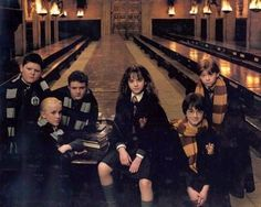 Let's all have scarfs and not tell Emma.<~~ Lets all have serious faces and not tell Daniel