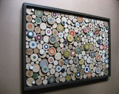 Made To Order Lead time up to 5 weeks  Rustic Wood Slice Art Sculpture Painted Tree Rings Abstract The same colors will be used. Placement and color combo will vary. Each piece will be truly unique. Made From reclaimed tree branches  Custom Size and Colors Available!.   Size: Approx. 24x36 Framed  Made from fallen tree branches, cut into wood slices. Some have painted bulls eyes with different colors for both a modern and rustic look! Hangs easily on any wall in your home with a wood frame…