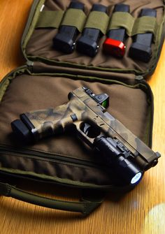 Glock 34 GEN 4 MOS custom Camo, decked out with components from Trijicon, Surefire, Agency Arms and Taran Tactical.
