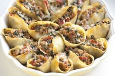 Sausage Stuffed Shells Recipe with Spinach from www.inspiredtaste.net #pasta #recipe    Will be trying this.
