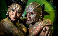 Uruguayan tatoo artists Victor Hugo Peralta and his wife, Gabriela Peralta are listed on the Guinness World Records as the married couple with the most body modifications