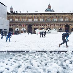 Snow fight! Piazza Maggiore, Bologna - Instagram by itsnotjustaboutfood