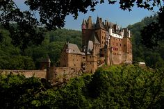 Eltz Castle is situated in the hills between Koblenz and Trier in West Germany. It is one of the best preserved medieval castles in Germany and has been owned by the same branch of family for over 800 years.