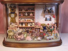 The Teddy Bear Store ~ A Miniature by T. Vanterpool ~ I've never counted all the bears and accessories in this vignette. The Teddy Bear Store is in a Cortland Doan case which is lighted and has a removeable stage that you can change out for holidays or seasons....