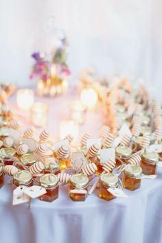 Bottled honey as wedding favors - how sweet! #wedding #diywedding #weddingfavors…