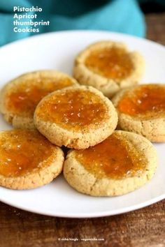 vegan, How to make the best Pistachio Apricot Thumbprint Cookies that melt in your mouth. Pistachio shortbread cookies filled with Apricot Jam. Vegan Cookie Recipe