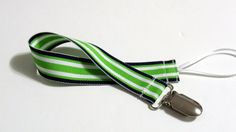 Pacifier Holder lime black ribbon with a ribbon loop and a metal pacifier clip. Keep that pacifier off the floor and clean with this pacifier