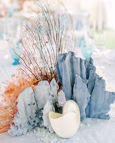 23 Non-Floral Wedding Centerpiece Ideas [ Who needs knots and sailboats when you can connote a nautical wedding theme with various creatures of the deep, like c. Coral Wedding Centerpieces, Seashell Centerpieces, Beach Wedding Decorations, Wedding Flower Arrangements, Centerpiece Ideas, Coral Wedding Decorations, Nautical Centerpiece, Nautical Wreath, Centrepieces