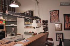 create space in the little kitchen with a repurposed ladder for pots 'n pan?