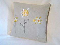 Turn your child's drawing in to a cushion cover!  Using a carefully chosen mix of designer and vintage fabrics, I can turn your child's drawing in to an appliqued design on a linen cushion cover.  I use free motion applique to capture the intricate details and whimsical character of children's drawings.  I will work with you to choose a co-ordinating fabric for the back, from my range of designer prints including Amy Butler, Joel Dewberry and Heather Bailey.  The price shown here is a…