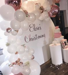 A beautiful organic balloon arch with added flowers. Perfect décor for a baby girls christening. Not forgetting our cake plinths which are just perfect for showing off your beautiful cake.