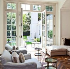 Wide, full height windows and entrance will not only bring light and air, but also the greenery outside, into the living room.