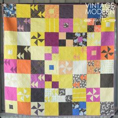 Dimensions: 80″ x  80″  Fabrics:  Bella Solids (Berrylicious, Boysenberry, Clementine, Longhorn, Mustard, Saffron, Dark Denim, Eggplant, Grape, Moda U Brown, Almond), Hope Valley and Katie Jump Rope by Denyse Schmidt, Far Far Away 2 by Heather Ross, Dobby Voile and Innocent Crush by Anna Maria Horner and others  Pattern: City Aviation by Cherry House from the book City Quilts