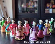 Nine beautiful girls in Indian attire. Made with quilling strips. Ht: 4 please note: this paper figurine set is not a toy for young children. Keep it away from sunlight as colors may fade for durability. Quilling Dolls, Quilling Paper Craft, Quilling 3d, Paper Crafts, Quilling Tutorial, Quilling Ideas, Clay Crafts, Paper Quilling Cards, Paper Quilling Patterns