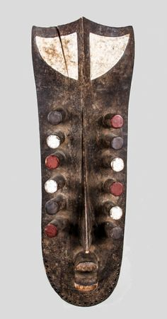 Africa | Large Grebo mask | Wood and pigment