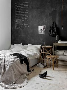 Bedroom with black chalkboard wall