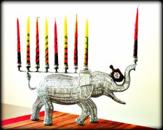 I found the right color candles on my teenage daughter's Menorah. Roll tide.